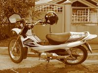 A Honda XRM with modified seat cover